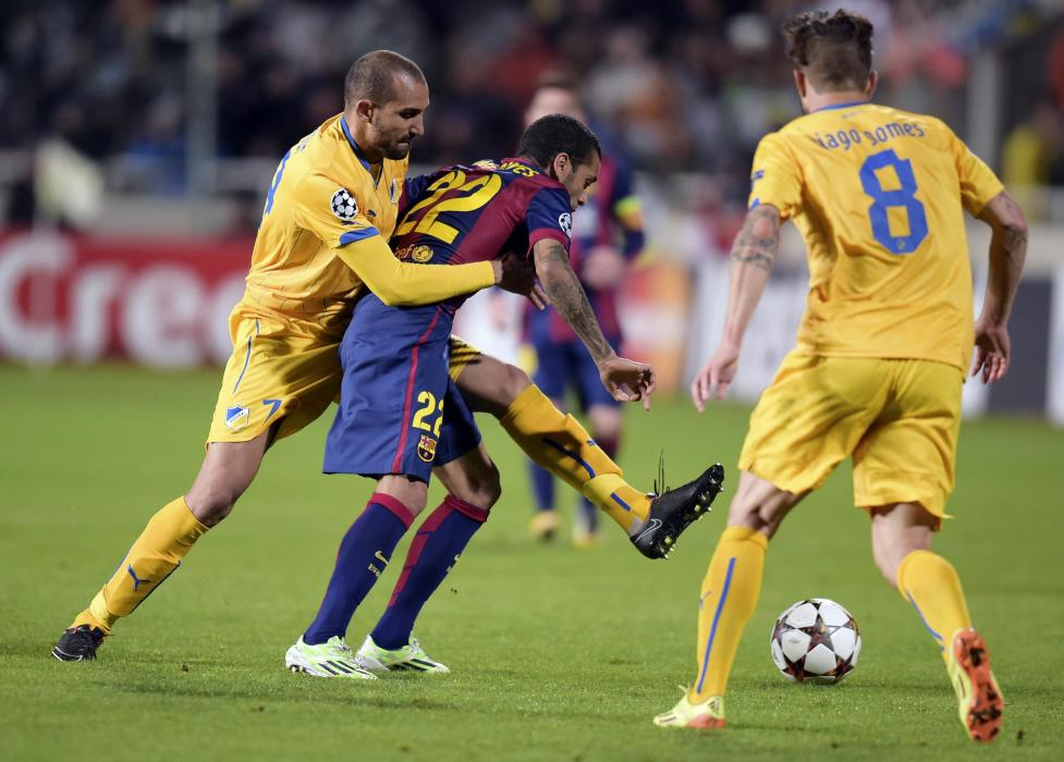 APOEL Nicosia's Djebbour fights for the ball with Barcelona's Alves during their Champions League Group F soccer match in Nicosia