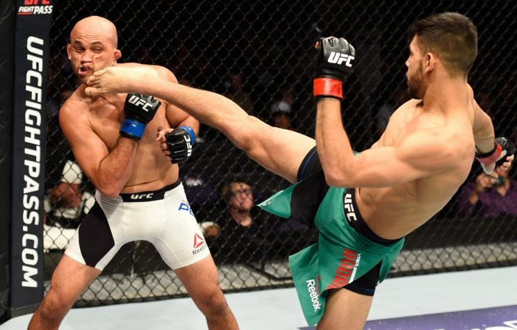 Yair Rodriguez kicks B.J. Penn during his second-round TKO victory in their featherweight bout in Phoenix on Sunday. (Jeff Bottari/Getty Images)