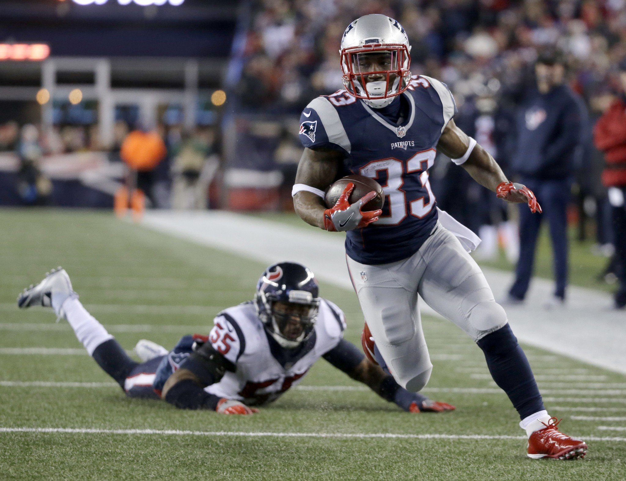 Dion Lewis scored three touchdowns for the Patriots in his postseason debut. (AP)