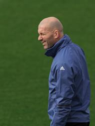 Real Madrid's head coach Zinedine Zidane blinks an eye during a training session at the Valdebebas stadium ahead of Wednesday's Champions League soccer match between Real Madrid and Napoli, in Madrid, Spain, Tuesday, Feb. 14, 2017 . (AP Photo/Daniel Ochoa de Olza)
