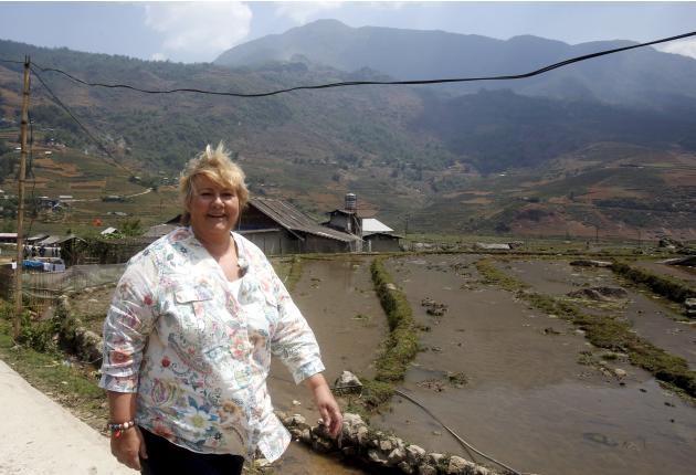 Norway's Prime Minister Erna Solberg is pictured during her visit to ethnic Hmong communities in Sapa