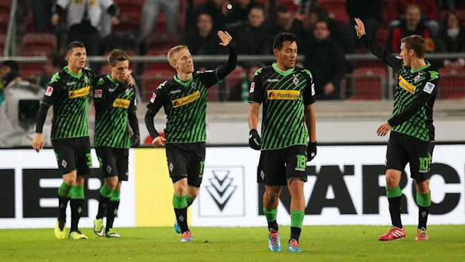 Moenchengladbach's players celebrate their side's second goal during the German first division Bundesliga soccer match between VfB Stuttgart and Borussia Moenchengladbach Stuttgart, Germany, Friday, Nov. 22, 2013