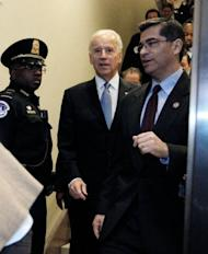 "US Vice President Joe Biden arrives with Representative Xavier Becerra (R) to the US Capitol to meet with reluctant House Democrats on January 1, 2013 in Washington, DC. After fervent New Year brinkmanship, the US Congress Tuesday finally backed a deal to avert a ""fiscal cliff"" of tax hikes and slashing spending cuts that had threatened to unleash economic calamity."
