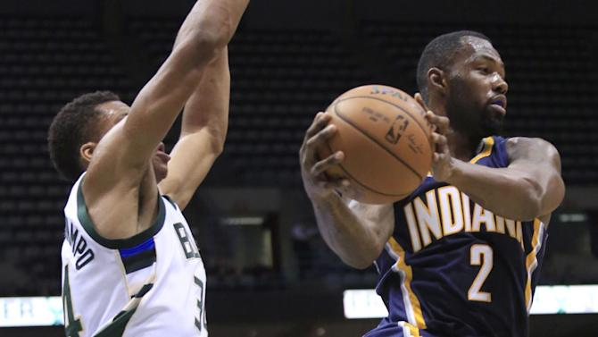 Indiana Pacers guard Rodney Stuckey, right, drives next to Milwaukee Bucks forward Giannis Antetokounmpo, left, during the first half of an NBA preseason basketball game Wednesday, Oct. 19, 2016, in Milwaukee. (AP Photo/Darren Hauck)