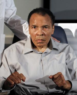 FILE - Former heavyweight boxing champion Muhammad Ali displays his signature boxing pose after honoring outstanding surgeons and physicians at St. Joseph's Hospital Barrow Neurological Institute, in this Feb. 22, 2012 file photo taken in Phoenix. Retired boxing champion Muhammad Ali will be awarded the medal on Thursday Sept. 13, 2012 at a ceremony at the National Constitution Center in Philadelphia. The honor is given annually to an individual who displays courage and conviction while striving to secure liberty for people worldwide. It comes with a $100,000 cash prize. (AP Photo/Ross D. Franklin, File)