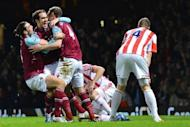West Ham United's Irish defender Joey O'Brien (2nd L) celebrates after scoring a goal during the English Premier League football match between West Ham and Stoke City at the Boleyn Ground, Upton Park, in East London, England. The match ended in a 1-1 draw