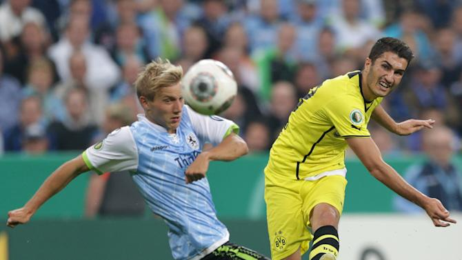 Munich's Stefan Wannenwetsch, left, and Dortmund's Nuri Sahin of Turkey challenge for the ball during the German soccer cup second round match between TSV 1860 Munich and Borussia Dortmund, in Munich, southern Germany, Tuesday, Sept. 24, 2013