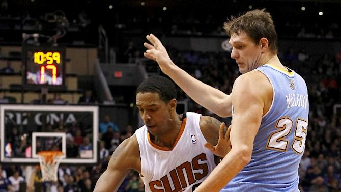 Phoenix Suns forward Channing Frye, left, drives on Denver Nuggets center Timofey Mozgov (25) in the third quarter of an NBA basketball game, Sunday, Jan. 19, 2014, in Phoenix