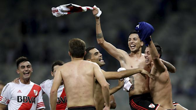 Playes of Argentina's River Plate celebrate after winning their Copa Libertadores soccer match against Brazil's Cruzeiro in Belo Horizonte