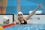 China's Ye Shiwen celebrates after winning the women's 400m individual medley final swimming event at the London 2012 Olympic Games. Yi won Olympic gold in the women's 400m medley in a world record of 4min 28.43sec