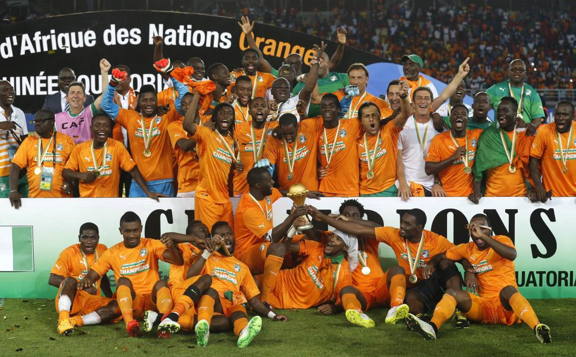 Ivory Coast's players celebrate with the trophy after winning the African Nations Cup final match against Ghana in Bata