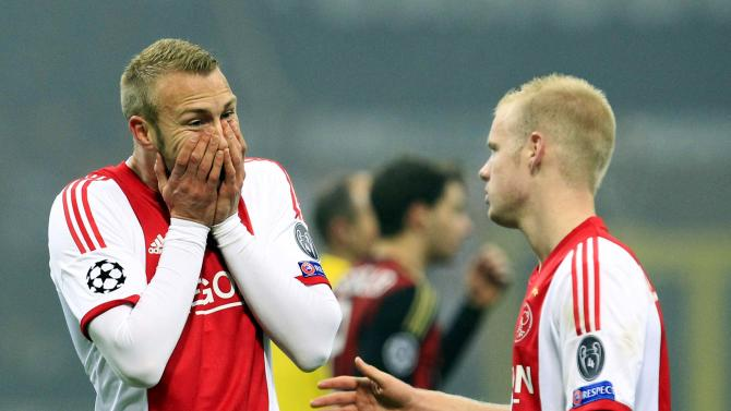 Ajax Amsterdam's van der Hoorn and Klaassen react after their Champions League soccer match against AC Milan in Milan