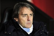 Manchester City manager Roberto Mancini saw his side lose 3-1 at Southampton, on February 9, 2013. Mancini's side needed a victory at St Mary's to keep the pressure on leaders Manchester United, but instead they slumped to their third league defeat of the season