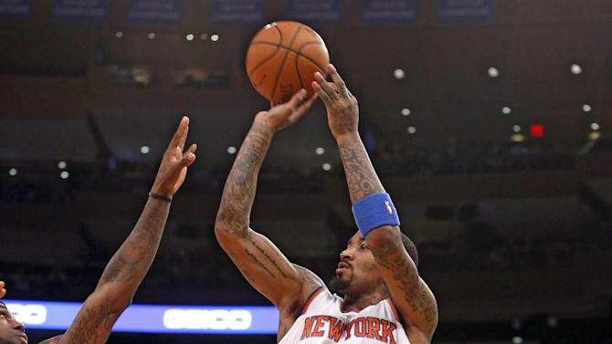 New York Knicks' J.R. Smith (8) shoots against Miami Heat's LeBron James (6) during the first half of an NBA basketball game Saturday, Feb. 1, 2014, in New York. (AP Photo/Jason DeCrow)