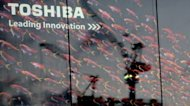 Toshiba's logo on the outside of an electrical shop in Tokyo. The Japanese electronics giant says it will pay about $850 mn for IBM's retail products unit, with the US firm saying it would create the world's leading point-of-sale company
