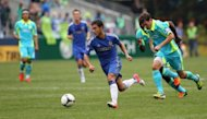 Eden Hazard of Chelsea FC dribbles against Brad Evans of the Seattle Sounders FC at CenturyLink Field in Seattle, Washington on July 18. Hazard will be joined by his younger brother Thorgan at Chelsea, the Premier League side has said, after completing his signing from French club Lens