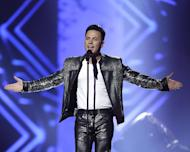 "Ryan Dolan of Ireland performs his song ""Only Your Love Survives"" during a rehearsal for the final of the Eurovision Song Contest at the Malmo Arena in Malmo, Sweden, Friday, May 17, 2013. The contest is run by European television broadcasters with the event being held in Sweden as they won the competition in 2012, the final will be held in Malmo on May 18. (AP Photo/Alastair Grant)"