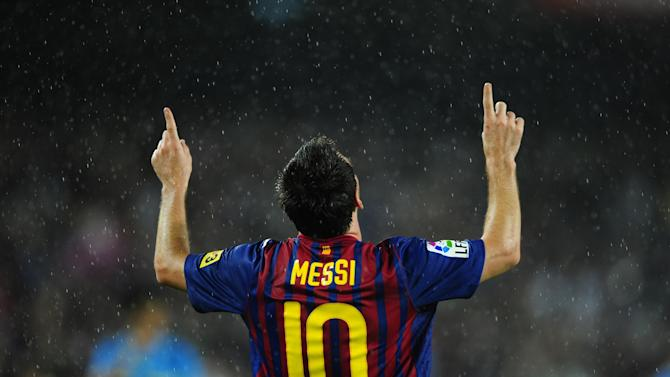 FC Barcelona's Lionel Messi, from Argentina, reacts after scoring against Atletico Madrid during a Spanish La Liga soccer match at the Camp Nou stadium in Barcelona, Spain, Saturday, Sept. 24, 2011. (AP Photo/Manu Fernandez)