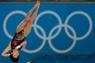 China's Chen Ruolin competes in the women's 10m platform final during the diving event at the London 2012 Olympic Games. Chen was in a class of her own Thursday, defending her women's Olympic 10m platform diving crown in dominating style