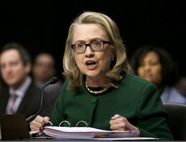 FILE - In this Jan. 23, 2014, then-Secretary of State Hillary Rodham testifies on Capitol Hill in Washington before the Senate Foreign Relations Committee hearing on the deadly September attack on the