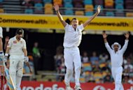 South African bowler Morne Morkel (C) appeals unsuccessfully for the wicket of Australian batsman Ed Cowan (L) on day three of the first cricket Test between South Africa and Australia at the Gabba ground in Brisbane. South Africa were on track to end Australia's unbeaten 24-year Test run at the Gabba after dominating the third day's play