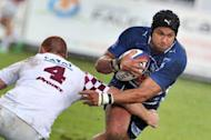 Bordeaux-Bègles' Cameron Tréolard (L) tackles Agen's centre Manu Ahotaeiloa (R) during their French Top 14 rugby union match. Bordeaux defeated Agen 29-15