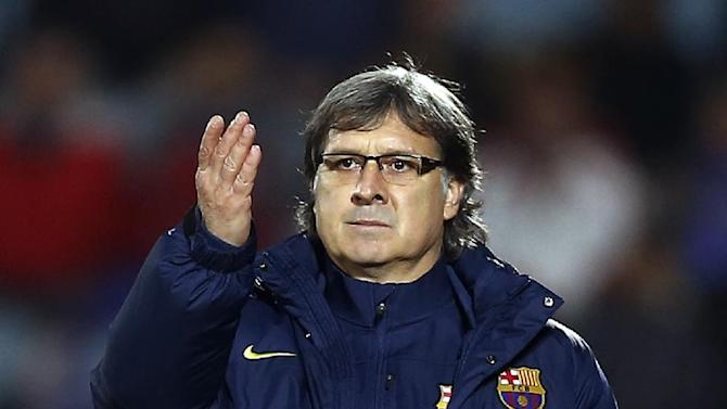 FC Barcelona's coach Gerardo 'Tata' Martino from Argentina is seen during a Spanish La Liga soccer match between FC Barcelona and Getafe at the Coliseum Alfonso Perez stadium in Madrid, Spain, Sunday, Dec. 22, 2013