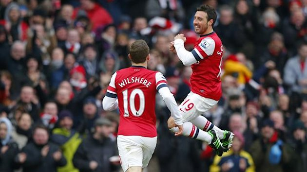 Santi Cazorla (R) of Arsenal celebrates after scoring his team's first goal against Aston Villa during their English Premier League soccer match at the Emirates Stadium in London February 23, 2013 (Reuters)