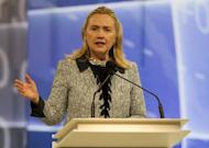 """US Secretary of State Hillary Clinton gives a speech at the APEC CEO Summit meeting, part of the Asia-Pacific Economic Cooperation (APEC) summit in Honolulu, Hawaii, on November 11. Clinton said that Myanmar needed to do """"much more"""" to improve human rights despite what she saw as signs of change by the military-backed government"""