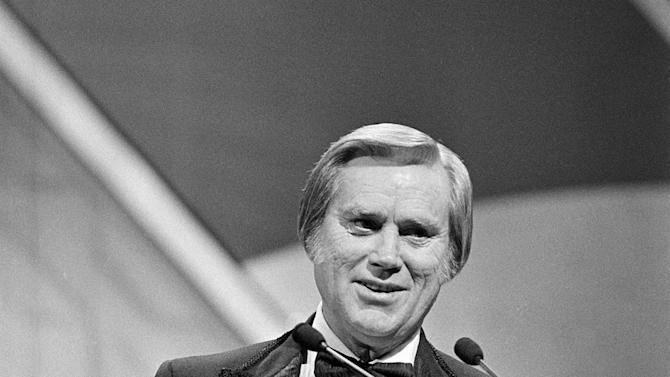 "FILE - In this Oct. 1986 file photo,   George Jones accepts his 1985 award at the Country Music Association (CMA) awards show in Nashville, Tenn.   Jones, the peerless, hard-living country singer who recorded dozens of hits about good times and regrets and peaked with the heartbreaking classic ""He Stopped Loving Her Today,"" has died. He was 81. Jones died Friday, April 26, 2013 at Vanderbilt University Medical Center in Nashville after being hospitalized with fever and irregular blood pressure, according to his publicist Kirt Webster.  (AP Photo, file)"
