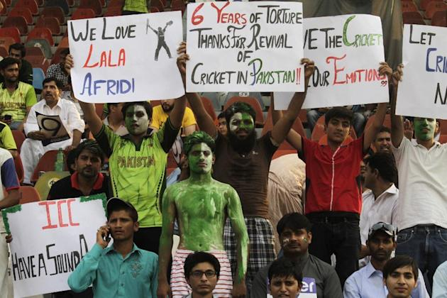 Pakistan's cricket fans welcome the Zimbabwe cricket team at the Gaddafi stadium in Lahore, Pakistan, Friday, May 22, 2015. The game marks a return of international cricket to Pakistan for the fir