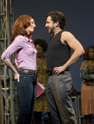 "In this theater image released by Boneau/Bryan-Brown, Jessica Phillips, left, and Raul Esparza are shown during a performance of ""Leap of Faith,"" at the St. James Theatre in New York. (AP Photo/Boneau/Bryan-Brown, Joan Marcus)"
