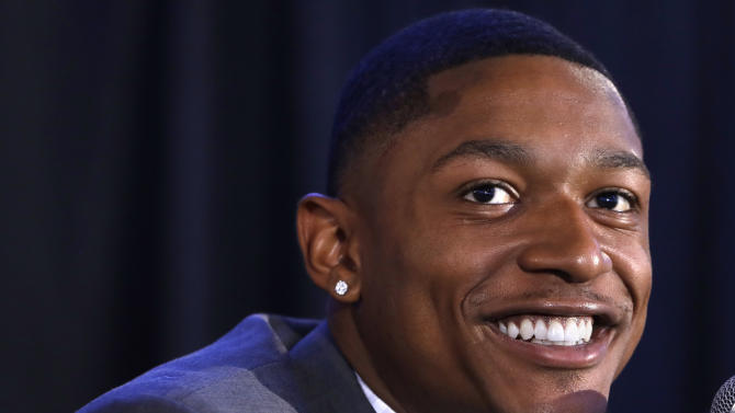 Washington Wizards guard Bradley Beal smiles during a news conference about his re-signing with the NBA basketball team, in Washington, Wednesday, July 27, 2016. (AP Photo/Jacquelyn Martin)