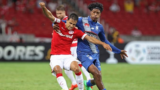 Narvaez of Ecuador's Emelec challenges Nilmar of Brazil's Internacional during their Copa Libertadores soccer match in Porto Alegre