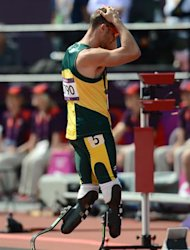South Africa's Oscar Pistorius looks dejected after competing in the men's 4X400m relay heats at the athletics event during the London 2012 Olympic Games on August 9, 2012 in London. AFP PHOTO / FRANCK FIFE