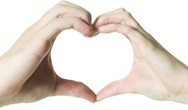 Hands make the symbol of a heart (Thinkstock)