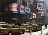 Signs in New York's Times Square show the MSN logo January 15, 2002. REUTERS/Jeff Christensen/Files