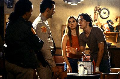 Trooper Weston ( Avis-Marie Barnes ) and Trooper Gideon ( Jon Beshara ) listen to Justin Long and Gina Philips in United Artists Films Jeepers Creepers