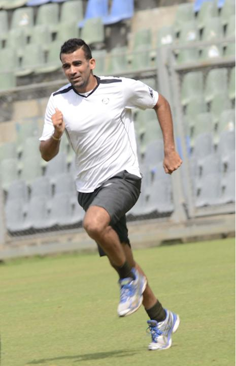 Mumbai captain Zaheer Khan practices at Wankhede stadium ahead of Ranji Trophy match against Haryana in Lahli, Rohtak in Mumbai on Oct.24, 2013. (Photo: Sandeep Mahankaal/IANS)