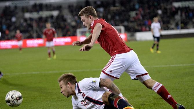 Norway's Marcus Pedersen, below, and Denmark's Emil Larsen vie for the ball during their international friendly match in Herning, Denmark, Friday, Nov. 15. 2013