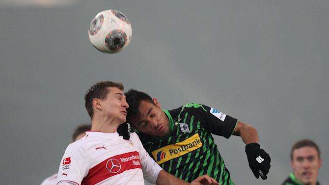 Stuttgart's Daniel Schwaab, left, and Moenchengladbach's Juan Arango challenge for the ball during the German first division Bundesliga soccer match between VfB Stuttgart and Borussia Moenchengladbach Stuttgart, Germany, Friday, Nov. 22, 2013