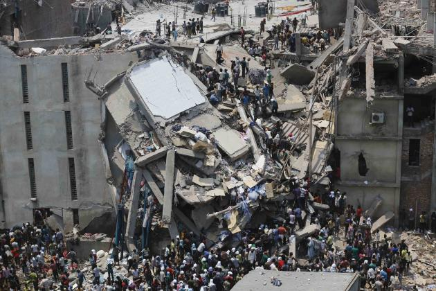 File photo of people rescuing garment workers trapped under rubble at the Rana Plaza building, near Dhaka, after it collapsed