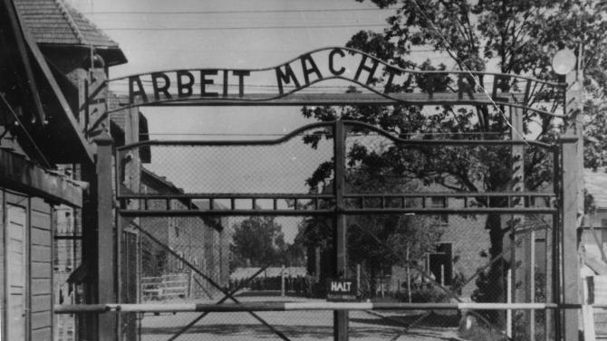"This undated file image shows the main gate of the Nazi concentration camp Auschwitz I, Poland, which was liberated by the Russians in January 1945. Writing over the gate reads: ""Arbeit macht frei"" (Work makes free - or work liberates). The lawyer for Nazi war crimes suspect Johann ""Hans"" Breyer says the 89-year-old Philadelphia man died Tuesday, July 22, 2014 while awaiting extradition to Germany. German prosecutors had hoped to try Breyer on charges of aiding in the murder of more than 200,000 Jews at the Auschwitz death camp. (AP Photo/File)"