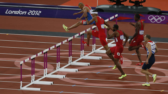 Felix Sanchez of the Dominican Republic clears a hurdle as he competes in the men's 400m hurdles final during the London 2012 Olympic Games