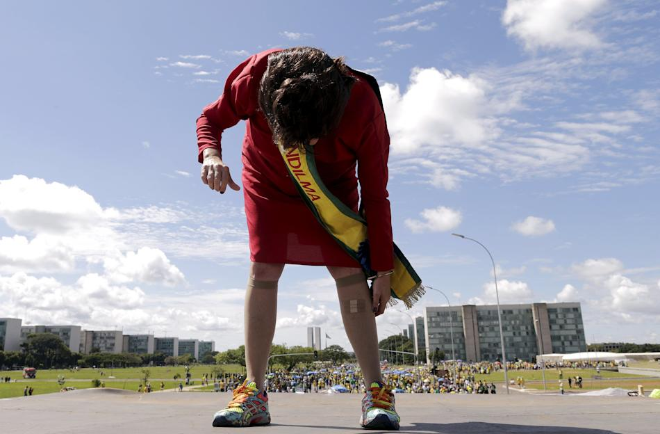 Demonstrator dressed as Brazil's President Dilma Rousseff takes part during a protest against Rousseff in Brasilia