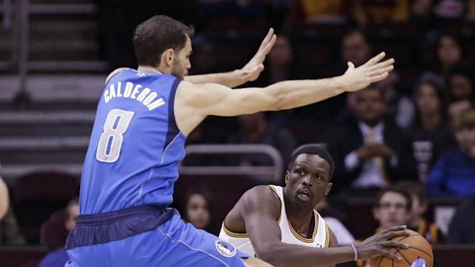 CORRECTS FROM LOUL TO LUOL- Cleveland Cavaliers' Luol Deng, right, from Sudan, looks for help under pressure from Dallas Mavericks' Jose Calderon, left, from Spain, during the first quarter of an NBA basketball game Monday, Jan. 20, 2014, in Cleveland