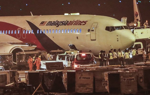 A Malaysia Airlines flight heading to India with 166 people aboard made an emergency landing in Kuala Lumpur early Monday after it was forced to turn back when a tire burst upon takeoff, the airline said. (AP Photo)