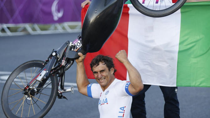Italy's Alessandro Zanardi lifts his hand-cycle after winning the Men's Individual H4 - Road Race during the London 2012 Paralympic Games
