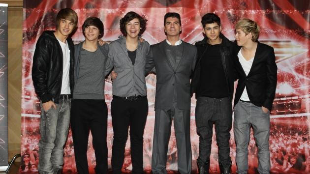 One Direction pose with Simon Cowell for a photocall to promote the UK 'X-Factor' final held at The Connaught Hotel, London, on December 9, 2010 -- Getty Images