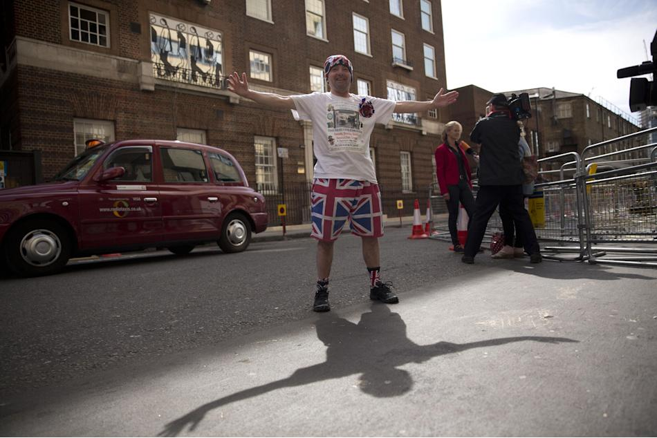 Royal fan John Loughrey poses for the media outside the Lindo Wing of St Mary's Hospital, London, Friday, April 17, 2015.  Britain's Kate the Duchess of Cambridge is expected to give birth to
